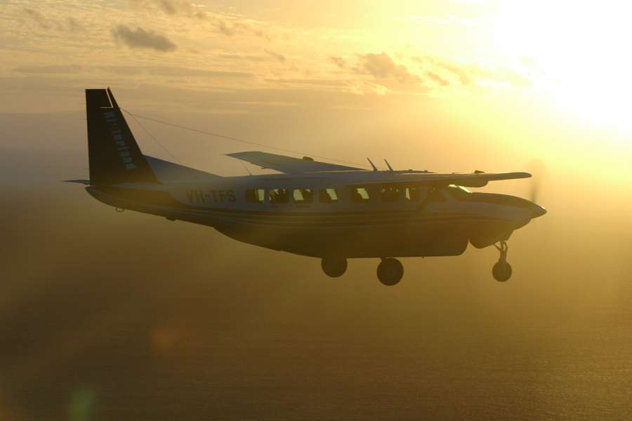 small plane on route from Cooktown to Cairns at sunset