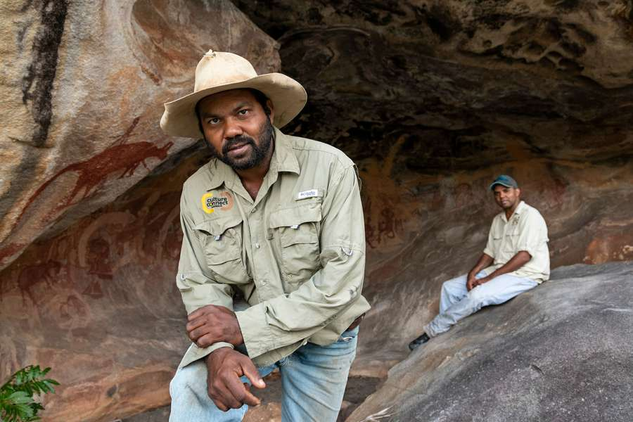 Two indigenous guides from Cape York standing in front of rock art gallery